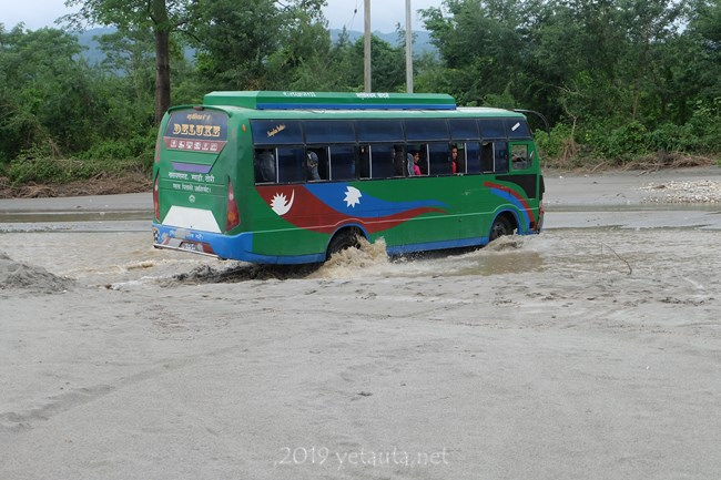 bus going in water